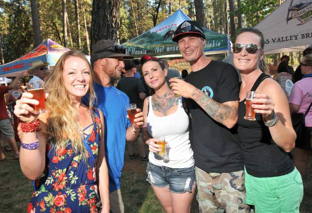 From left, Nevada County's Jaimelyn Ferrante and husband Michael, Heather Tackett, Chris Tsalemtzis, and Anna Dillavoa enjoy the many different beers on tap at the Nevada County Fairgrounds Saturday during the annual Sierra Brewfest.
