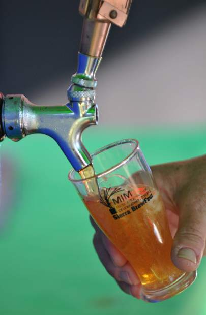 A glass is filled with Sierra Nevada's Sidecar beer during Saturday's Sierra Brewfest.