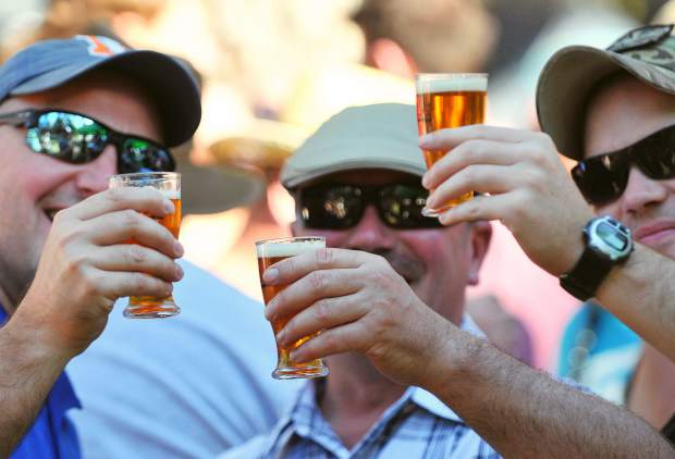 Beale Air Force Base service members (from left) Sean Widauf, Ron Lambert, and Bryan Townsend, enjoy some time off the base at Saturday's beer festival.