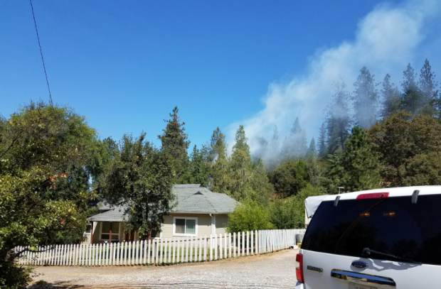 A fire in Colfax was fully contained to less than an acre by late afternoon Tuesday. The fire was reportedly sparked by a resident mowing in the area.