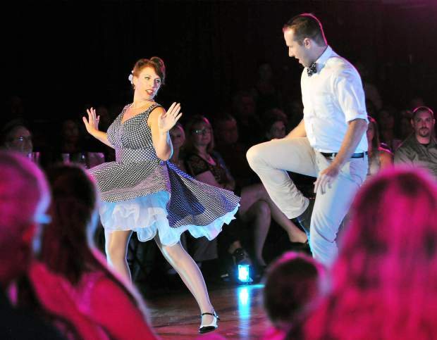 Dance pro Dori Delgado (left) swing dances along with Casey Burke during the first round of dance performances in the 5th annual Dancing With Our Stars fundraising event for the Center for the Arts.