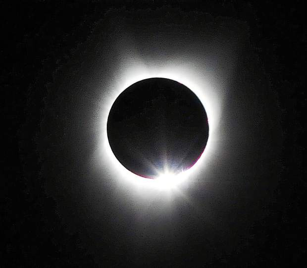 The moon enters a total eclipse of the sun Monday morning above Terrebonne in central Oregon.