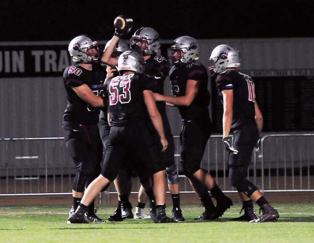 Bear River players celebrate after a Tre Maronic (24) defensive touchdown during a game against Orland Friday. Maronic, a sophomore, also caught a touchdown pass in the Bruins' victory.