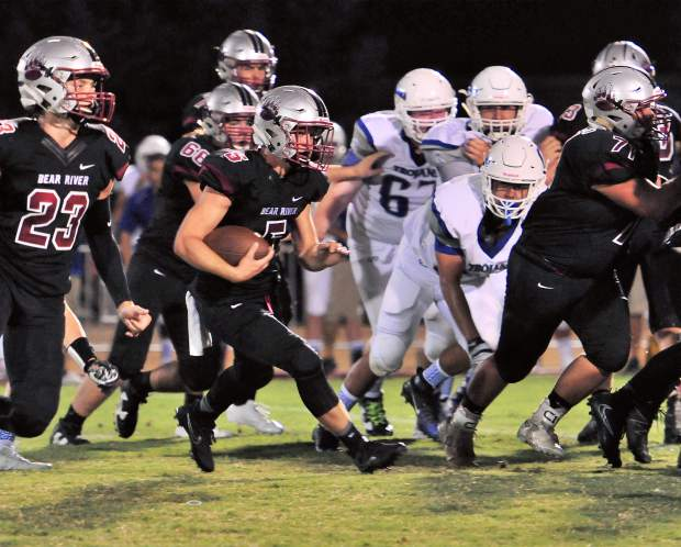 Bear River's Josh Zimmer carries the ball during a game against Orland Friday. The Bruins topped the Trojans 49-7.