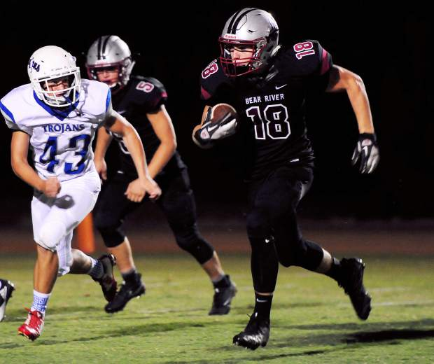 Bear River's Cameron Pratt runs with the ball during a game against Orland Friday. The Bruins topped the Trojans 49-7.