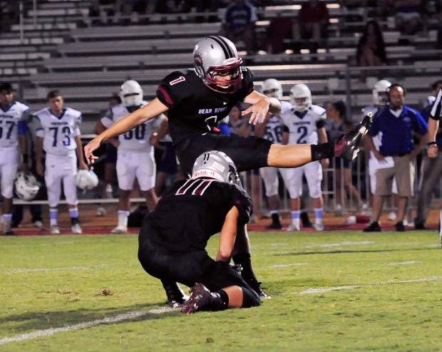 Bear River's Alex Bohn kicks during a game against Orland Friday. Bohn was 7-for-7 on extra points. The Bruins topped the Trojans 49-7.