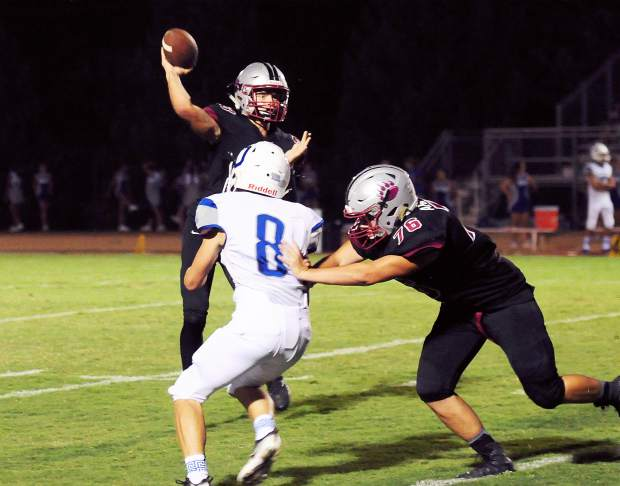 Bear River's Calder Kunde passes the ball during a game against Orland Friday. The Bruins topped the Trojans 49-7.