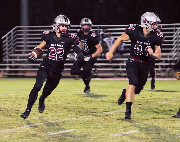 Bear River's Stephen Taylor (22) rushed for 146 yards and two touchdowns as the Bruins topped the Trojans 49-7.