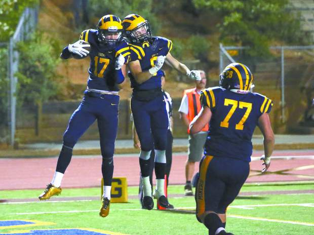 Nevada Union wide receiver Hayden Fay (17) celebrates after a touchdown against Napa at Hooper Stadium last year. Fay is back this season and will be a force for the Miners in the passing game.