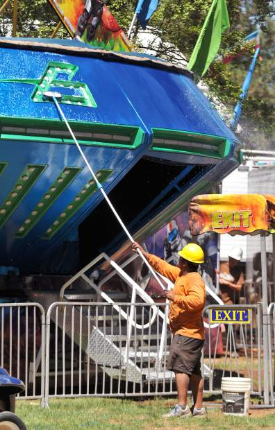 Employees from Oregon based Butler Entertainment, wash the rides such as the Gravitron, the day before the opening of the 2017 Nevada County Fair.