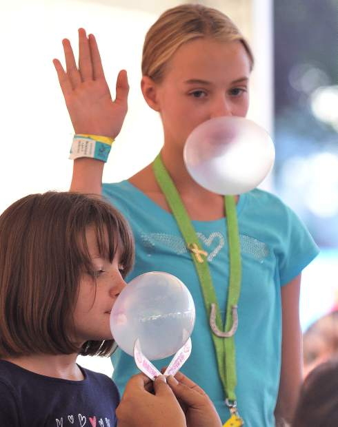 Ellie Spalding (left), and Harley Deschaine face off in the first ever bubble gum blow off competition at the Nevada County Fair Friday afternoon. The two were part of a day full of youth and family geared activities at the Special Events Tent Friday through each day of the fair.