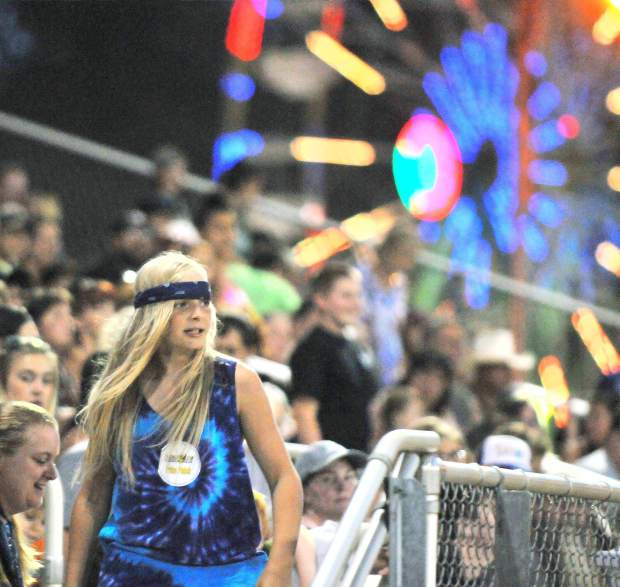 Folks in the crowd fill the grand stands of the Nevada County Fair for a night of high flying entertainment during the Flying U Extreme Rodeo.
