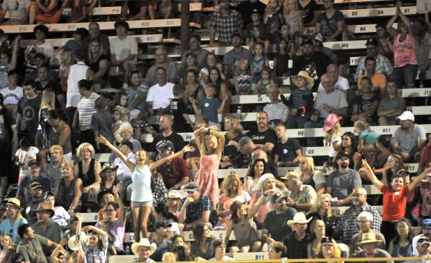 Folks dance in the crowd to win prizes during the Flying U Extreme Rodeo Wednesday night at the 2017 Nevada County Fair.