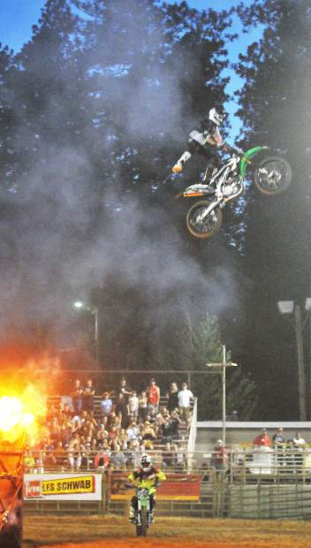 The flying cowboys take to the air with the help of ramps and motorcycles, during Wednesday and Thursday night's arena entertainment at the Nevada County Fair.