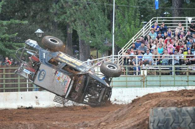 A tuff truck takes a spill during a heat, much to the delight of the crowd at the Nevada County Fairgrounds arena Friday night.