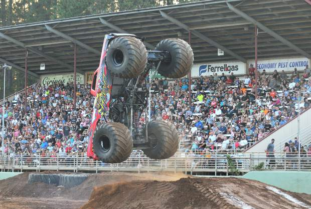 The monster truck Nitro Hornet goes vertical during Friday night's Nevada County Fair arena event which also featured tuff trucks.