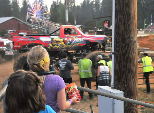 Spectators young and old watch their favorite monster trucks enter the arena during Friday and Saturday's monster truck and tuff truck competitions at the Nevada County Fair.