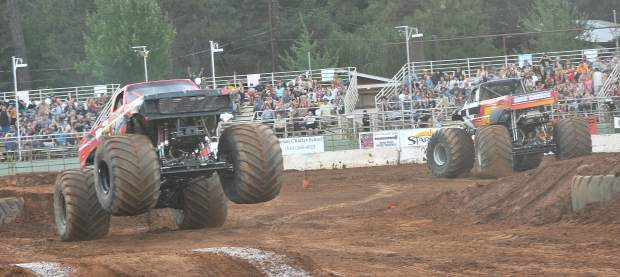 Monster trucks round the course at the Nevada County Fair's arena during Friday and Saturday nights' events at the fair.