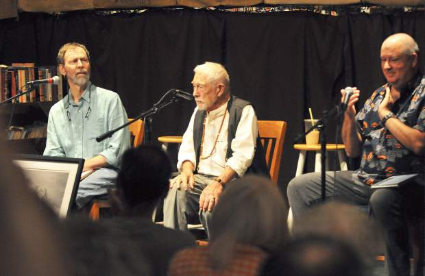 Local Pulitzer Prize winning poet Gary Snyder (center) answers questions from the crowd after reading some of his poems during Saturday's appearance at The Open Book in Grass Valley.