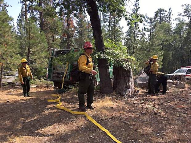 Firefighters had the Meadow Fire under control and kept to around 1/4 acre burned.