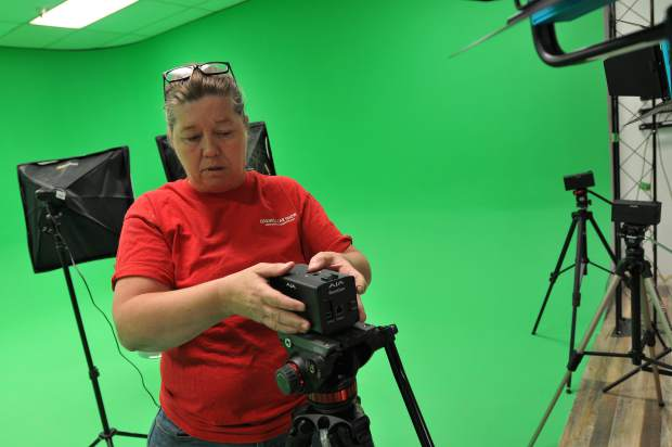 NCTV Executive Director Ramona Howard adjusts one of the AJA 4k cameras that will have the ability to be remotely operated from a nearby room.