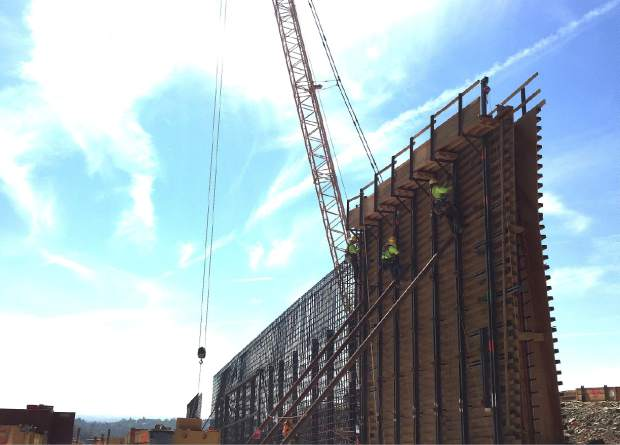 Workers work on forms that will be filled with concrete on the Oroville Dam Spillway, which was damaged in February.