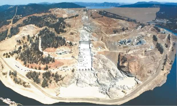 An overview photograph from Aug. 16 shows progress made and work still to be done on the Oroville Dam's flood control spillway.