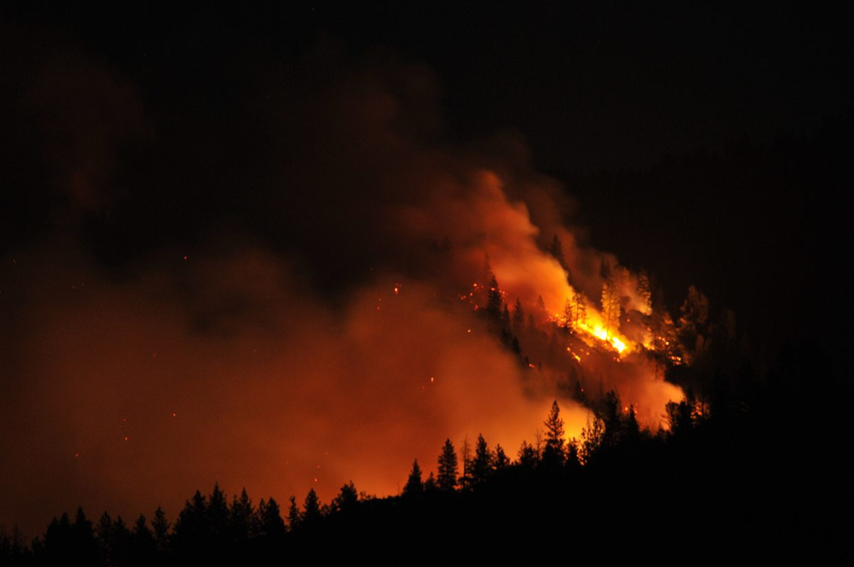 Flames from the Ponderosa Fire burning east of Oroville, light up the hillside as the wildfire burns approximately 1,000 acres, including a few homes. photo by Elias Funez/efunez@theunion.com