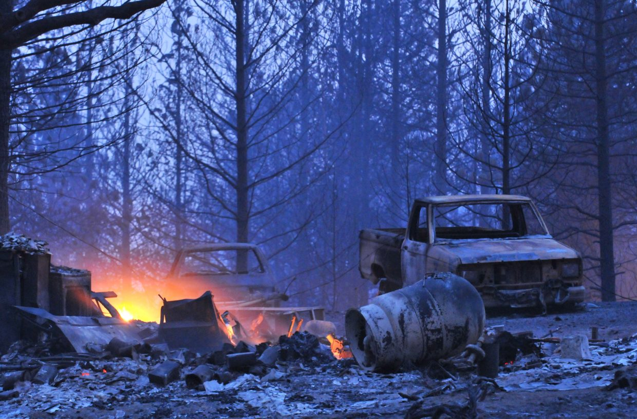 Vehicles sit charred off of Lumpkin Road in Butte County east of Oroville where approximately 1,000 acres have burned. photo by Elias Funez/efunez@theunion.com