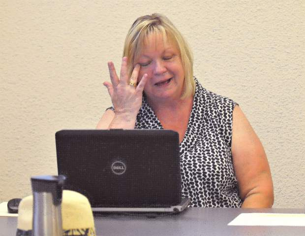 Board secretary and assistant to the superintendent Samie White, sheds a tear during Tuesday's ceremonies.