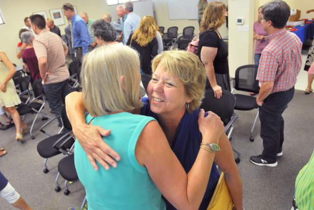 Alternative Education Administrative Assistant Diana Eli (right) gives an embrace to outgoing Superintendent Holly Hermansen.