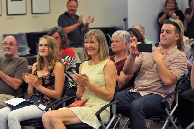 Members of the audience applaud the swearing in of new Superintendent Scott Lay.