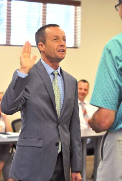 Newly appointed Nevada County Board of Education Superintendent Scott Lay is sworn in during a special board meeting Tuesday evening.