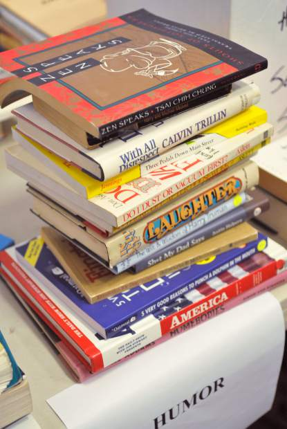 A stack of comedy books collects in the lobby of the Eric Rood Adminstrative Center in preparation for the upcoming annual book sale. The book sale raises money for the United Way of Nevada County, starts Monday and will last until Oct. 27.