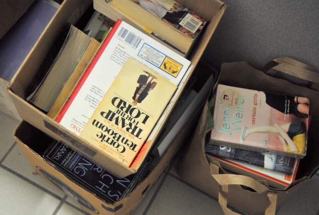 Hundreds of donated books wait to be sorted for the county's annual booksale set to begin Monday. The sale will benefit the United Way of Nevada County.