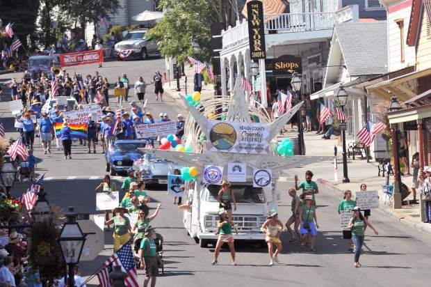 The Nevada County Cannabis Alliance's Constitution Day parade float rolls down Broad Street while dancers shake to the music during Sunday's parade.