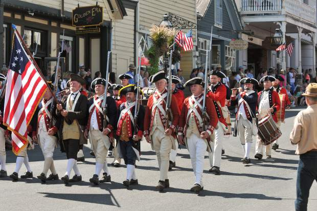 Members fo the Delaware Regiment of the Brigade of the American Revolution march down Broad street dressed in full regalia for Sunday's Constitution Day parade. The regiment offered living history demonstrations throughout Nevada City's Constitution Day weekend.
