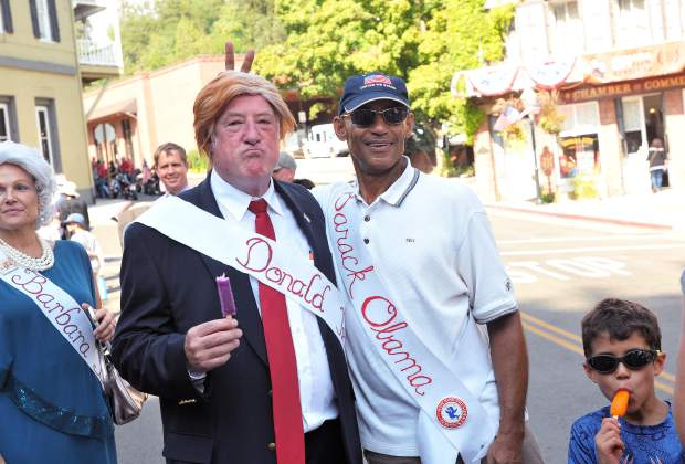 Donald Trump and Barack Obama share a jovial moment while taking pictures with Constitution Day event goers Sunday in downtown Nevada City.