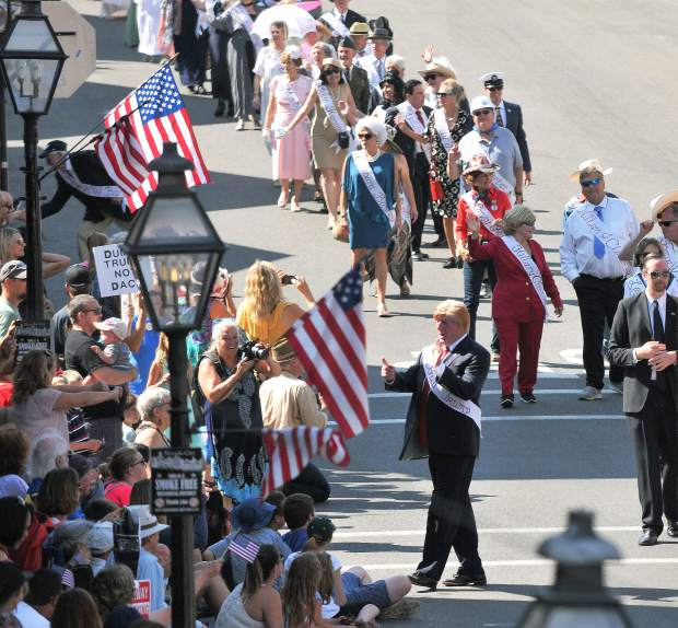 Constitution Day parade goers crowd Broad Street Sunday afternoon in order to get a good glimpse at Donald Trump, played by Nevada City's Rick Ewald, as he joins this year's Marching Presidents during the 51 annual Constitution Day weekend festivities.