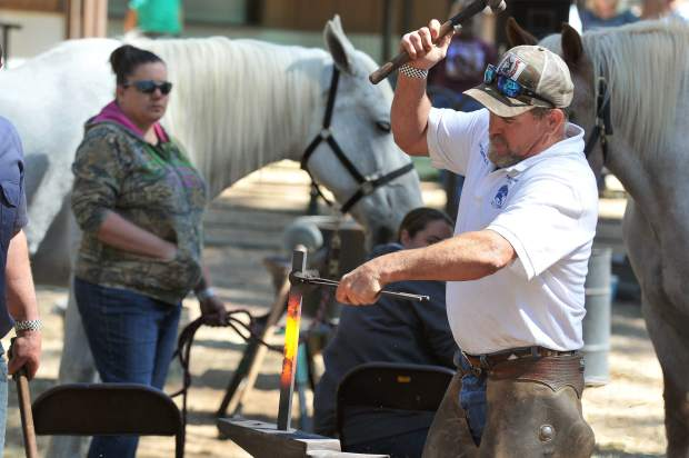 Horseshoeing competition judge Jason Harmeson begins to make a horseshoe from scratch as an example of what he will be looking for when judging competitors during the 2017 Draft Horse Classic at the Nevada County Fairgrounds Saturday.