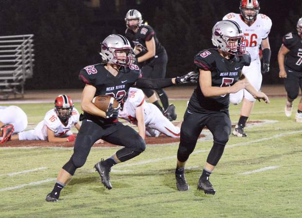 Bear River's Stephen Taylor runs behind the blocking of Josh Zimmer during a 31-10 victory over Pershing County Friday Night at J. David Ramsey Field.