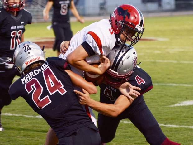 Tre Maronic (24) and Luke Baggett (4) converge on Pershing County's Martin Cholico during a 31-10 victory over Pershing County Friday Night at J. David Ramsey Field.
