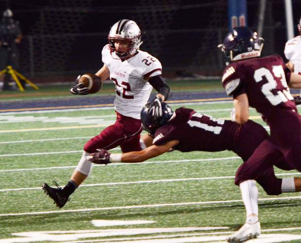 Bear River's Stephen Taylor carries the ball during a game against Union Mine Friday night. The Bruins won 20-0.