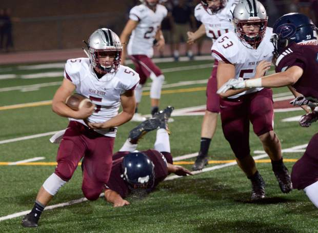 Bear River's Josh Zimmer runs the ball during a game against Union Mine Friday night. The Bruins won 20-0.