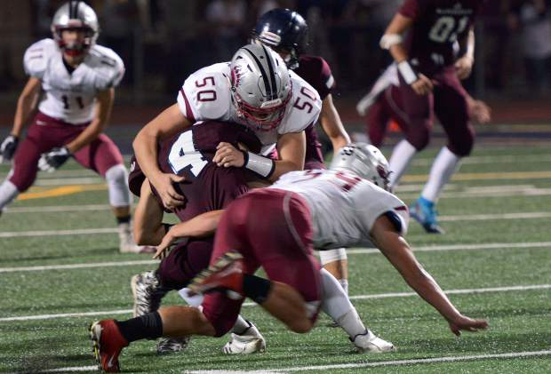 Bear River's Hayden Becker makes a tackle during a game against Union Mine Friday night. The Bruins won 20-0.