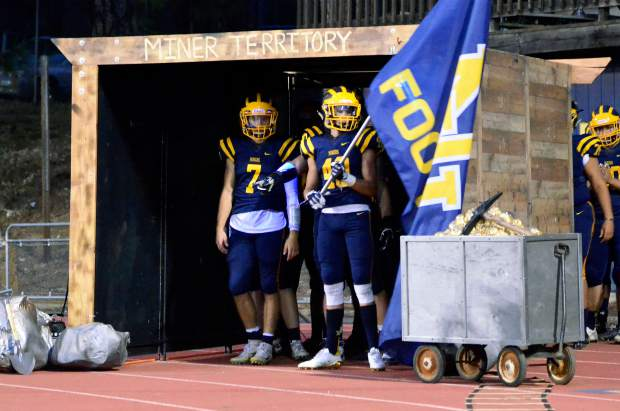 Garrett Graves and Owen Dal Bon get ready to lead the Miners out of a mock mine shaft ahead of NU's game against Placer.