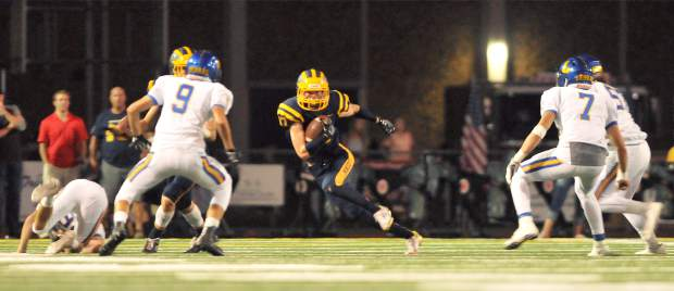 Nevada Union senior Hayden Fay maneuvers through the Lincoln defense during Friday night's home game against the Fighting Zebras.