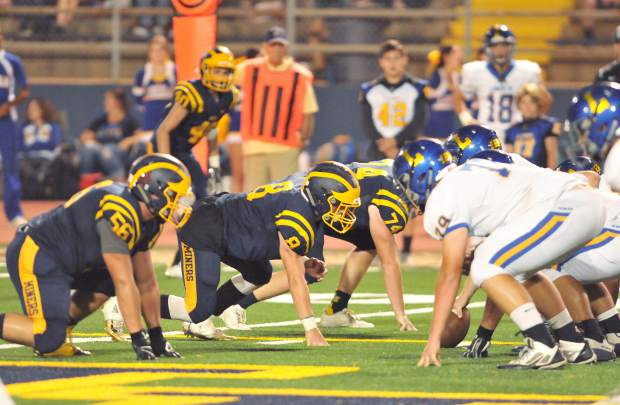 The Nevada Union defensive line readies to take on the Lincoln Zebras' offense Friday night at Hooper Stadium.