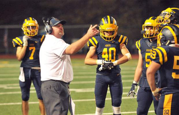 Nevada Union head coach Dennis Houlihan gives direction during Friday night's, 23-22, home loss to the Lincoln Fighting Zebras. The Miners are now 1-1 at home this season.
