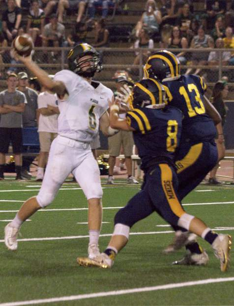 Nevada Union's Hayden Lee (8) and Cameron Dallago (13) put pressure of the quarterback during a game against Placer at Hooper Stadium Friday. The Miners topped the Hillmen, 43-16.